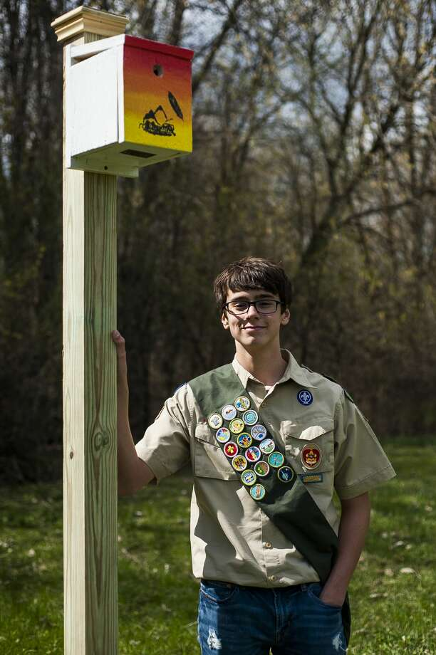 Connor McBride, a 15-year-old member of Boy Scout Troop 768, poses for a photo with one of the birdhouses, along with two bat houses, that were installed Friday, April 26, 2019 at Currie Golf Course as part of McBride's Eagle Scout project. (Katy Kildee/kkildee@mdn.net) Photo: (Katy Kildee/kkildee@mdn.net)