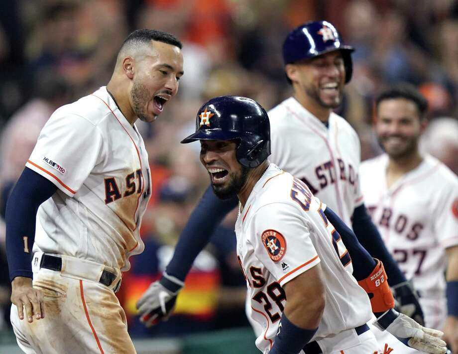 Houston Astros' Robinson Chirinos (28) celebrates with Carlos Correa, left, after hitting a three-run home run against the Cleveland Indians during the seventh inning of a baseball game Sunday, April 28, 2019, in Houston. (AP Photo/David J. Phillip) Photo: David J. Phillip, STF / Associated Press / Copyright 2019 The Associated Press. All rights reserved