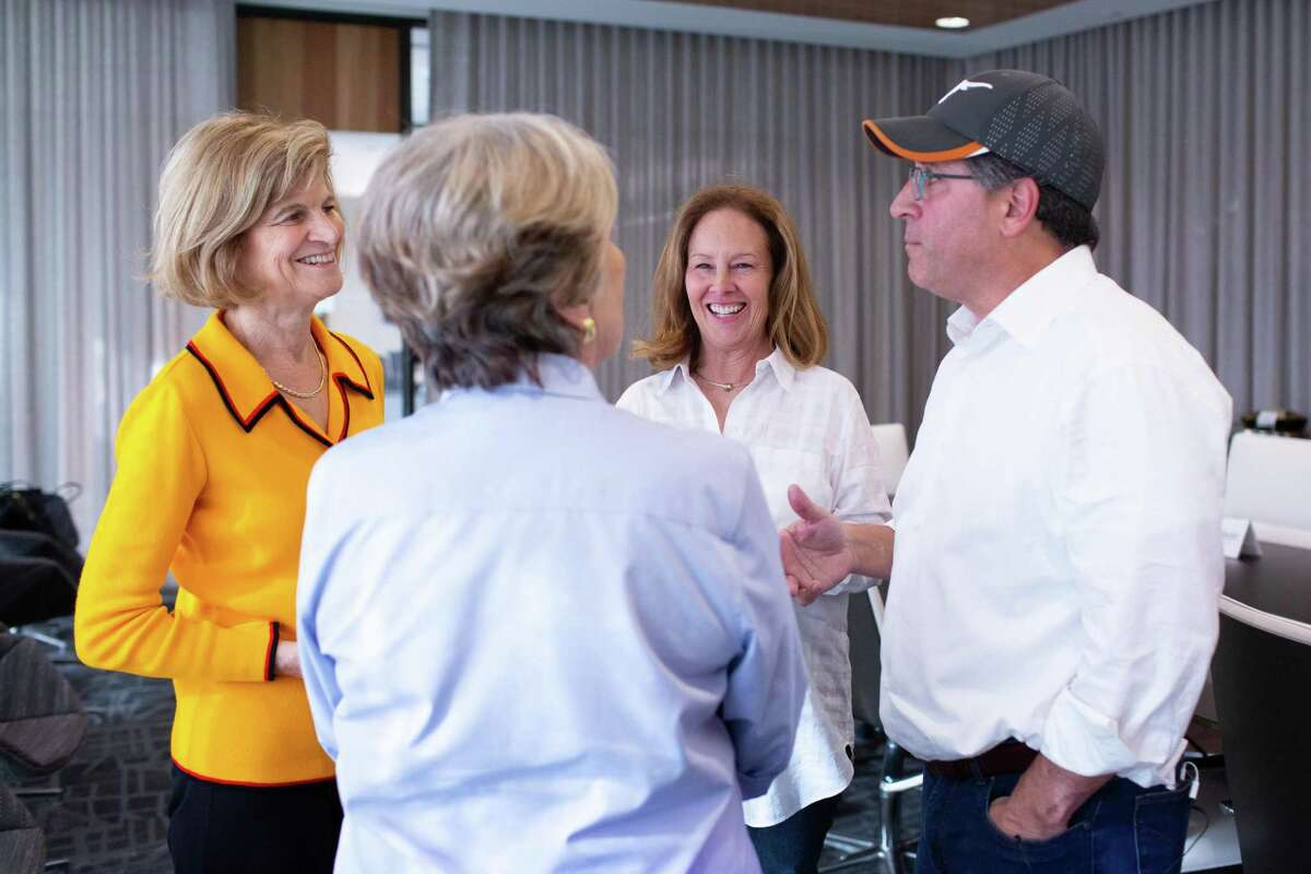 UT Tower Fellows mingle before a lecture by Professor Will Inboden,