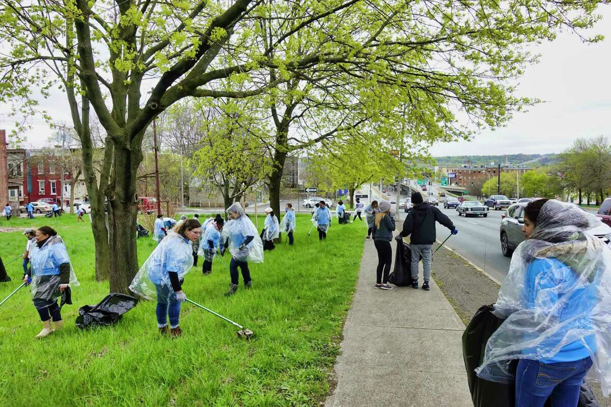 Members of the World Mission Society Church of God from New Windsor along with local volunteers, clean up around Hoosick Street on Sunday, April 28, 2019, in Troy, N.Y. The church has members who attend some of the colleges in the Capital Region. The cleanup is part of the Church of God's national and international environmental protection efforts. The church has 2.9 million members around the world, with congregations in 175 countries. (Paul Buckowski/Times Union)