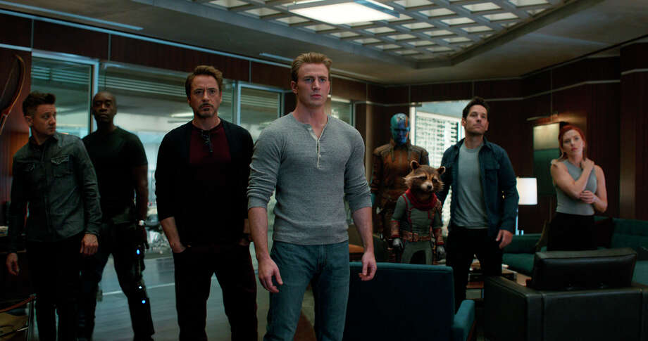 "This image released by Disney shows, from left, Jeremy Renner, Don Cheadle, Robert Downey Jr., Chris Evans, Karen Gillan, the character Rocket, voiced by Bradley Cooper, Paul Rudd and Scarlett Johansson in a scene from ""Avengers: Endgame."" (Disney/Marvel Studios via AP) / Disney/Marvel Studios"