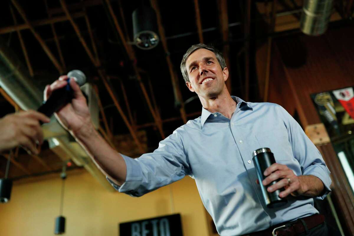 Democratic presidential candidate and former Texas congressman Beto O'Rourke is handed a microphone while speaking during a campaign stop Friday, April 26, 2019, in Henderson, Nev.