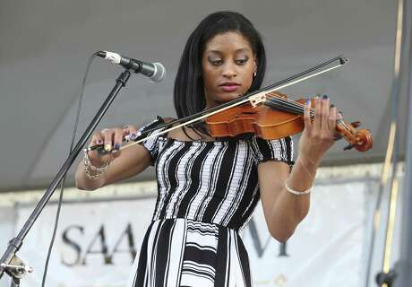 Mara Winters plays the fiddle that belonged to her great-grandfather, Ellis Griffin, an African American fiddler who resided in San Antonio in the 1920s, as she tells the story of her family's history at Fiesta Family Blues Festival on Friday.