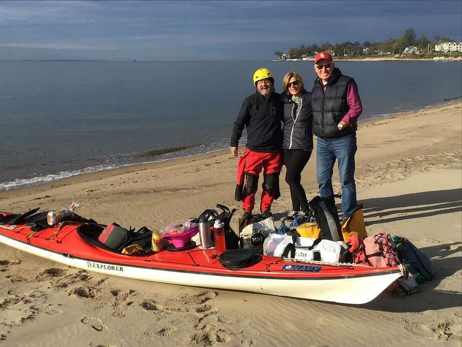 Chris and Sam Alesevich of Shelton hosted kayaker Steve Chard who is padding some 6,000 miles. He left from the West Haven shore Sunday morning. Photo: Chris Alesevich / Contributed Photo