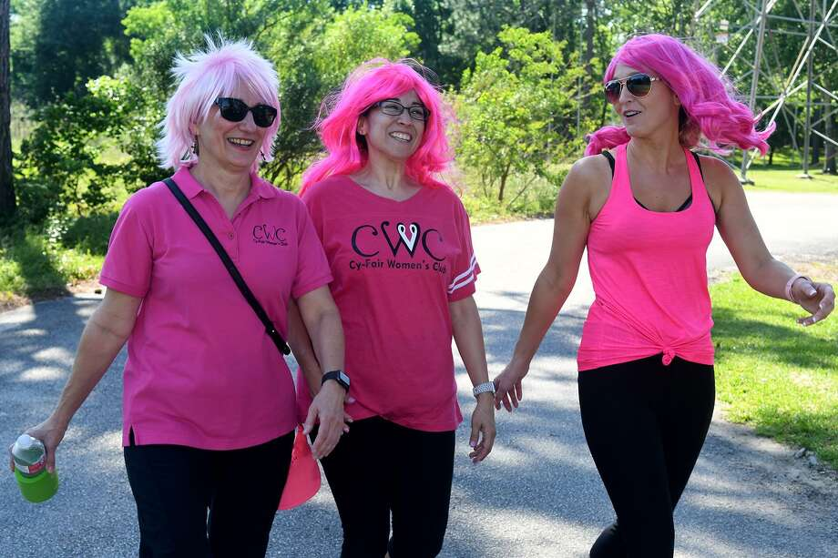Cathy Smith, from left, Roxanne Hartley, and Emily Buelsmith of the Cy-Fair Women's Club, walk their laps around the track during the Relay For Life event at Bayou City Fellowship in Cypress on Saturday. Photo: Jerry Baker, Houston Chronicle / Contributor / Houston Chronicle