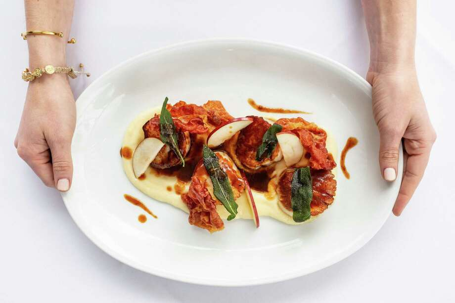 B.B. Italia Kitchen & Bar, opening May 2 at 14795 Memorial. is a new restaurant from Berg Hospitality Group (B& Butchers & Restaurant and B.B. Lemon) offering a menu of classic Italian-American food. Shown: Jumbo diver scallops saltimbocca with prosciutto, sage and demiglace. Photo: Kirsten Gilliam