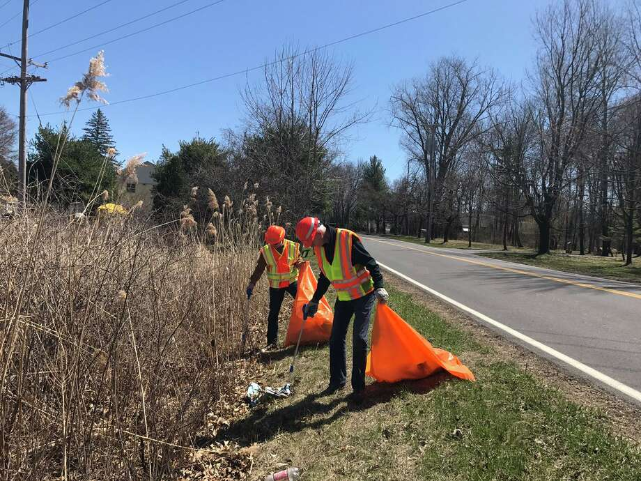 "State Department of Transportation employees were out en masse on roadways in April as part of the annual ""Trash Blitz"" cleanup effort. Photo: State Department Of Transportation"