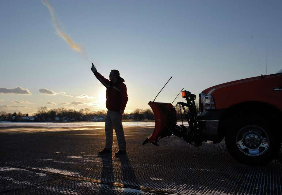 """Eric Larson, airport operations manager at Tweed-New Haven Airport, shoots a """"Bird Banger"""" pyrotechnics gun that shoots a projectile into the air that explodes and scares birds and other wildlife away from the runway. Photo: File Photo"""