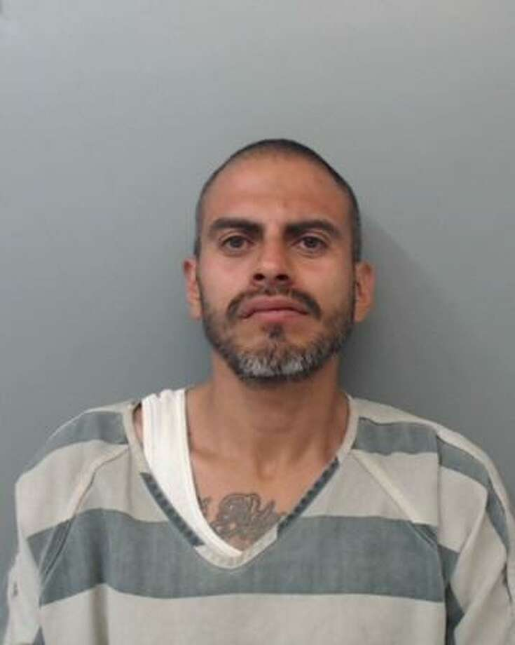 Roberto Esparza, 38, was arrested on Thursday and was served with a warrant charging him with aggravated robbery with knife or cutting instrument. Photo: /