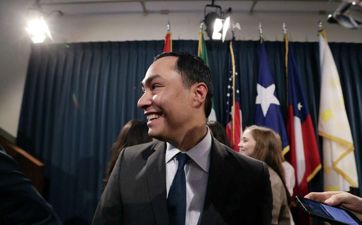U.S. Rep. Joaquin Castro, D-Texas, center, leaves a news conference with state senators where he addresses a GOP-backed resolution in the Texas Legislature supporting President Donald Trump's declaration of an emergency on the U.S.-Mexico border has reignited an immigration debate in the Capitol, Wednesday, April 17, 2019, in Austin, Texas. (AP Photo/Eric Gay)