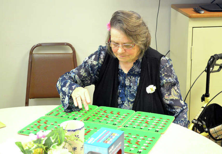 Linda Dillon, of Edwardsville, plays bingo during a Friday afternoon session at Main Street Community Center in Edwardsville. Photo: Scott Marion | The Intelligencer