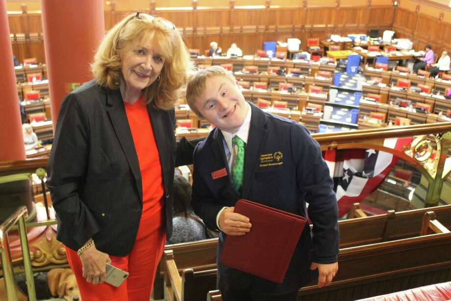 On April 26 at the state Capitol in Hartford, state Rep. Noreen Kokoruda, R-Madison, met with Special Olympics athletes who competed in the 2019 USA Games hosted by Abu Dhabi in March. She's shown here with athlete Chris Piotrowski of Durham. Photo: Contributed Photo