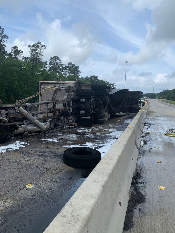 DPS responded to a scene around 9:15 a.m. after reports of a commercial vehicle striking a concrete barrier and being engulfed in flames near the Womack Overpass. Photo: Eric Williams