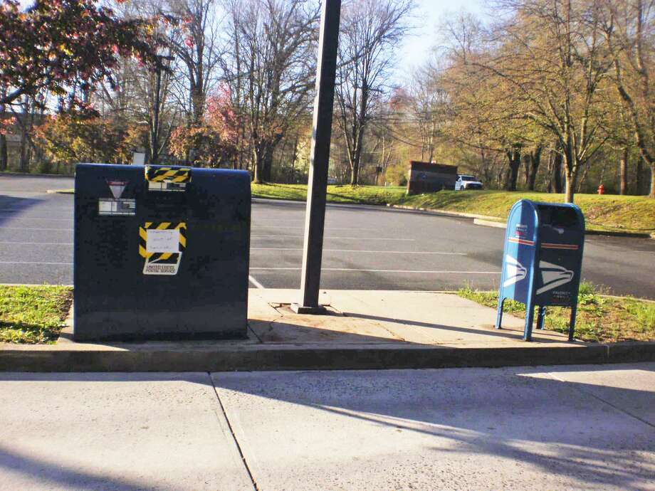 Someone broke into and stole mail from a USPS Express Mail drop box outside the Newtown Post Office on Commerce Road. Photo: Newtown Police Department / Facebook