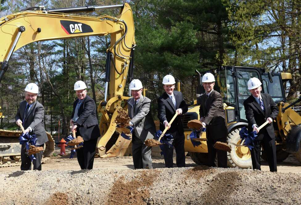 Breaking ground for a new medical complex with Albany Med and The Bone & Joint Center are; Dr. Steven Frisch, senior executive vice president for Albany Med, Dr. Stephen Hassett, principal, EmUrgentCare, Dr. David Quinn, orthopedic surgeon with The Bone & Joint Center, Clifton Park Town Supervisor, Phil Barrett, Richard Rosen, vice president of Columbia Development Companies and Dr. Dennis McKenna, executive vice president at Albany Med, right, on Monday, April 29, 2019, on Route 146 in Clifton Park, N.Y. The 14,400 square-foot medical complex will house an Albany Med EMUrgent Care facility as well as orthopedic satellite offices from The Bone & Joint Center. The facility is expected to open in October. (Will Waldron/Times Union)