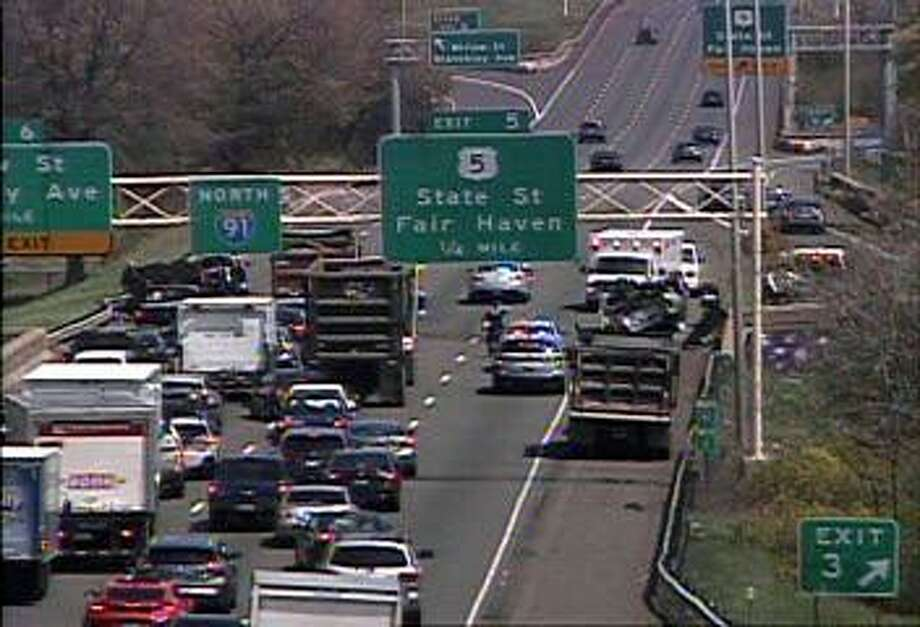 An overturned motor-vehile closed two lanes of two lanes of northbound I-91 on Monday, April 29, 2019. The two right lanes are closed between Exits 3 and 5. Photo: /
