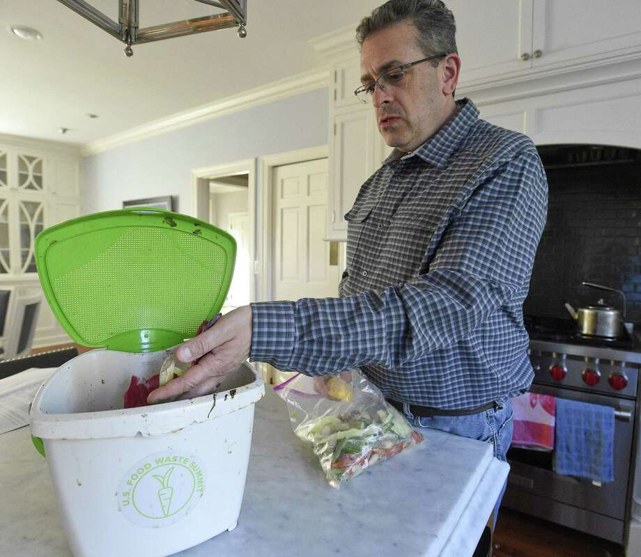 Thomas McQuillian shows off his composting efforts his family adheres to at his home in Greenwich on April 24, 2019. McQuillian, Vice President, Corporate Strategy, Culture and Sustainability at Baldor Specialty Foods, Inc., is an expert on eliminating food waste and has been composting all of his families foodwaste at home for the past five years. he is also responsible for his company greatly reducing food waste, sending all vegetable food scraps to be used by local pig farmers as a nutritious food source for the live stock. Photo: Matthew Brown / Hearst Connecticut Media / Stamford Advocate