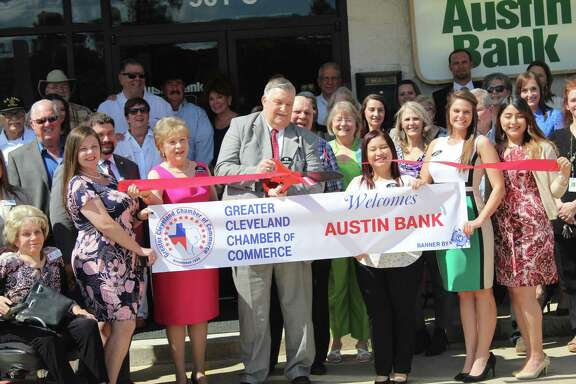 Mike Penry cuts the ribbon for the grand opening of the new Austin Bank in Cleveland on April 25.
