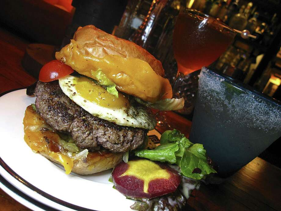 Sternewirth at the Pearl's Hotel Emma is a bar, first and foremost. And I went there for margarita research. But from the bar's short list of food — food with the pedigree of Emma's Supper American Eatery and chef John Brand — came a burger with big, beefy cheeseburger swagger in what I'll call a travel size. Not too big, not too small, but just right for a quick dinner or late reward. Juicy Peeler Farms beef, excellent cheddar, a rainbow of pickled vegetables and a sunny-side egg. This is not first-date food unless your date's as messy as you are. If they are? Keep them. And the burger. 36 E. Grayson St. at Hotel Emma, 210-223-7375, thehotelemma.com Photo: Mike Sutter /Staff