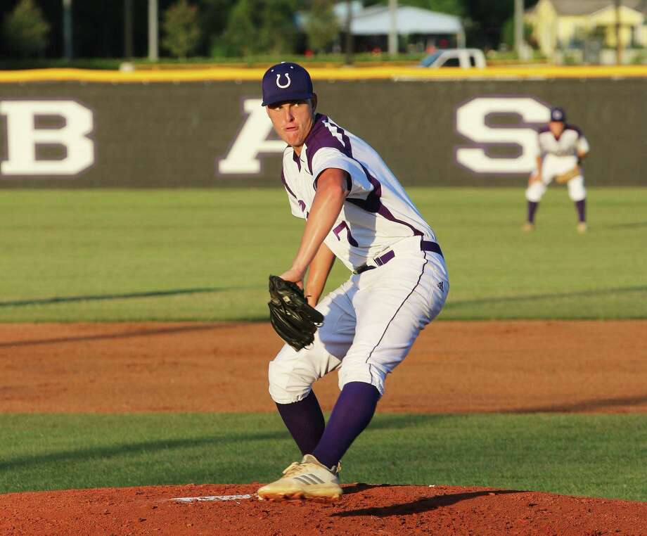 Cade Stapleton has an intense look on his face as he delivers a strike in the final district game against Port Arthur Memorial last Friday night. The Broncos secured a playoff spot with the 9-0 win. Photo: David Taylor / Staff Photo