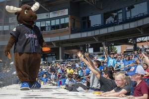 Juice the Moose tosses frisbees to fans 04/29/19 during a day game with the Midland RockHounds taking on the NW Arkansas Naturals at Security Bank Ballpark. Tim Fischer/Reporter-Telegram