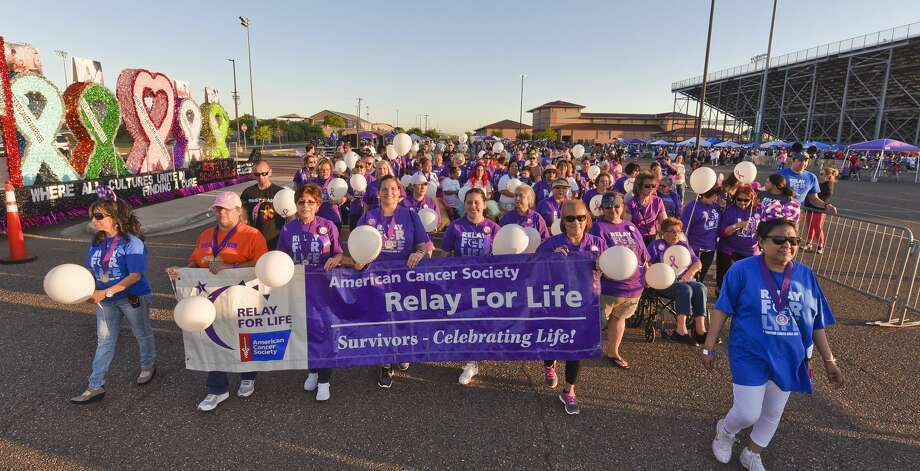 The crowd shows support for cancer survivors as they take the first lap in the Webb County Relay for Life Friday, Apr. 26, 2019, at the U.I.S.D. Student Activity Complex. Photo: Danny Zaragoza