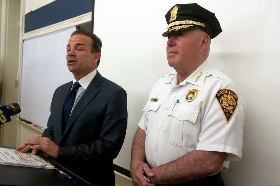 Mayor Joe Ganim stands with Chief Armando Perez as he speaks to the new class of recruits who were sworn in Monday April 29, 2019, in Bridgeport, Conn. Photo: Ned Gerard / Hearst Connecticut Media / Connecticut Post