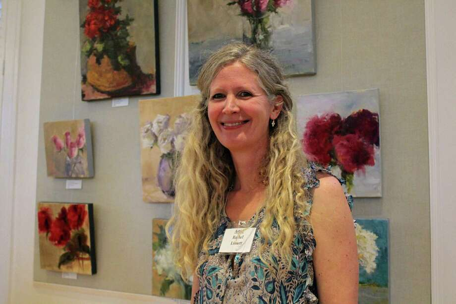 Artist Rachel Linnett in front of her collection of paintings for sale at the Westport Woman's Club's annual art show on April 27, 2019. Photo: Melanie Espinal / For Hearst Connecticut Media