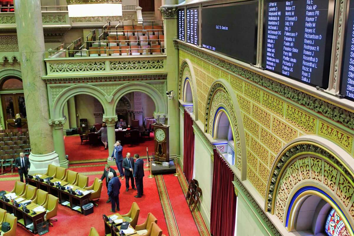 Members of the New York State Assembly make their way back onto the floor of the chamber before the start of session on Monday, April 29, 2019, in Albany, N.Y. (Paul Buckowski/Times Union)