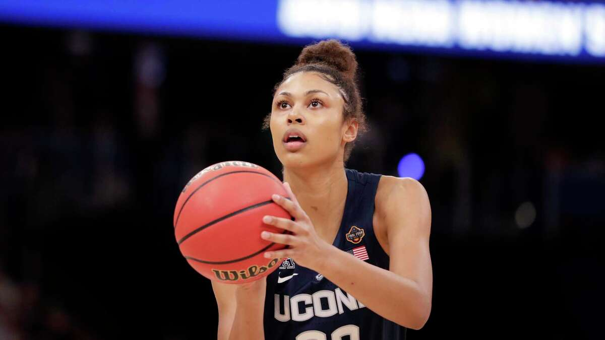 Connecticut forward Olivia Nelson-Ododa (20) aims a free throw, during the first half of a women's Final Four NCAA college basketball semifinal tournament game against Notre Dame, Friday, April 5, 2019, in Tampa, Fla. (AP Photo/John Raoux)