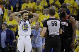 Golden State Warriors guard Stephen Curry (30) and Houston Rockets guard James Harden, right, react to a call in front of referee Josh Tiven (58) during the second half of Game 1 of a second-round NBA basketball playoff series in Oakland, Calif., Sunday, April 28, 2019. (AP Photo/Jeff Chiu)