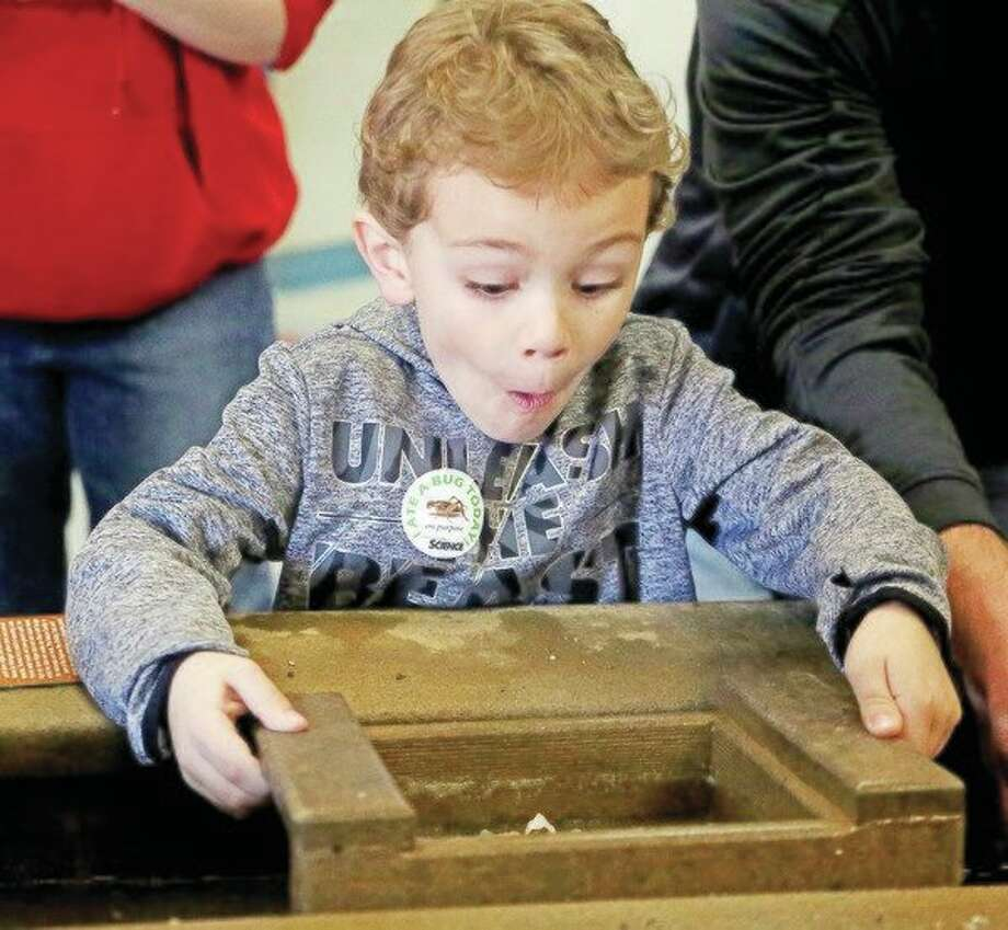 Isaiah Arntz, 6, of Bad Axe shows his excitement while sluicing for gemstones Saturday at the Thumb Area STEAM Showcase, hosted by the Bad Axe Middle School. For more pictures from the event, see Page 8A. (Paul P. Adams/Huron Daily Tribune)