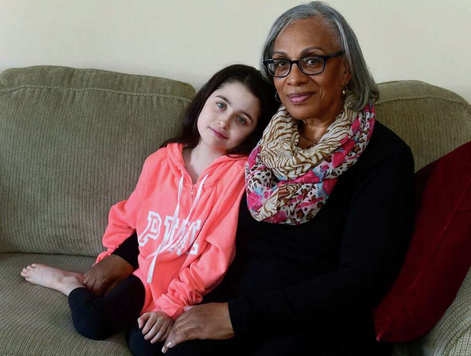 Jerlene Esaw and her adopted daughter Ashley Esaw, 12, in their home Tuesday, March 19, 2019, in Norwalk, Conn. Jerlene Esaw has fostered twenty children in the past including Ashely and has raised three children of her own. Photo: Erik Trautmann / Hearst Connecticut Media / Norwalk Hour