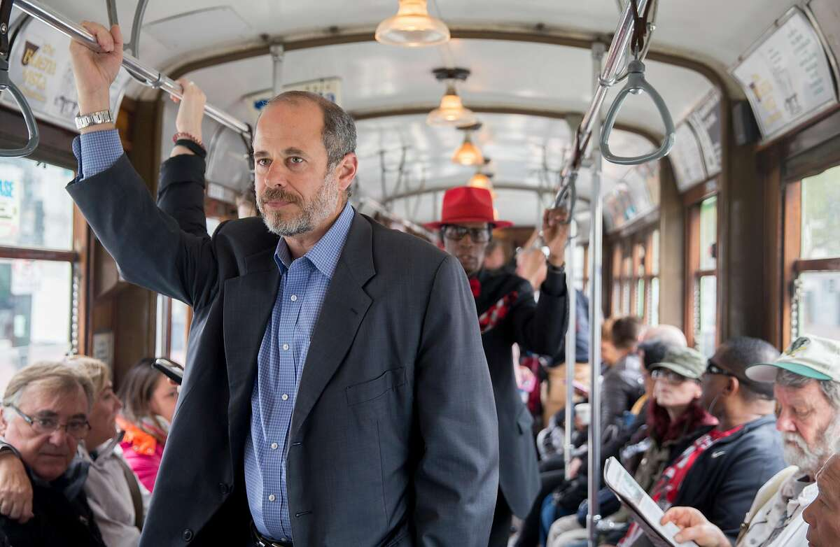 SFMTA Transit Chief Ed Reiskin rides a streetcar up Market Street from the SFMTA headquarters in San Francisco, Calif. Thursday, Aug. 23, 2018.