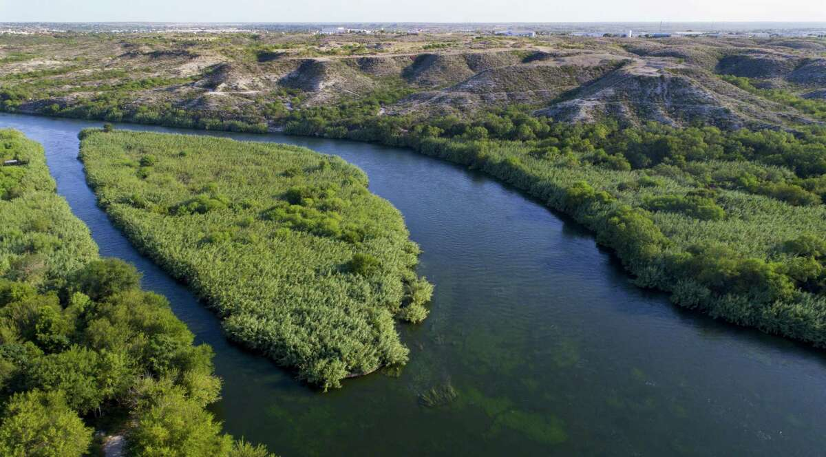 The Rio Grande River stretches between the United States (on the left) and Mexico near the border crossing at Del Rio, TX,Thursday, August 17, 2017. (Mark Mulligan / Houston Chronicle)