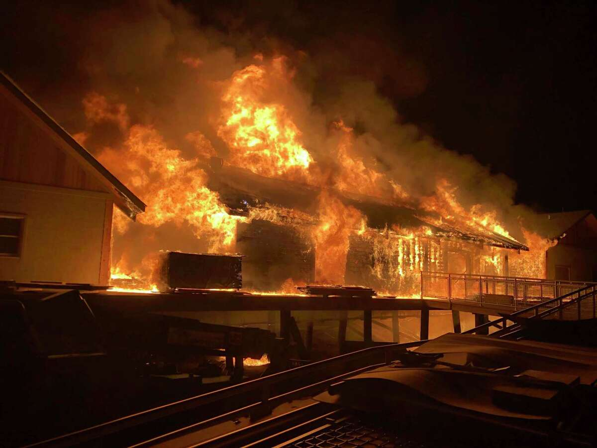 Fire rages at Silver Sands State Park Tuesday, March 19, destroying several buildings constructed as part of a $9.1 million park improvement project.