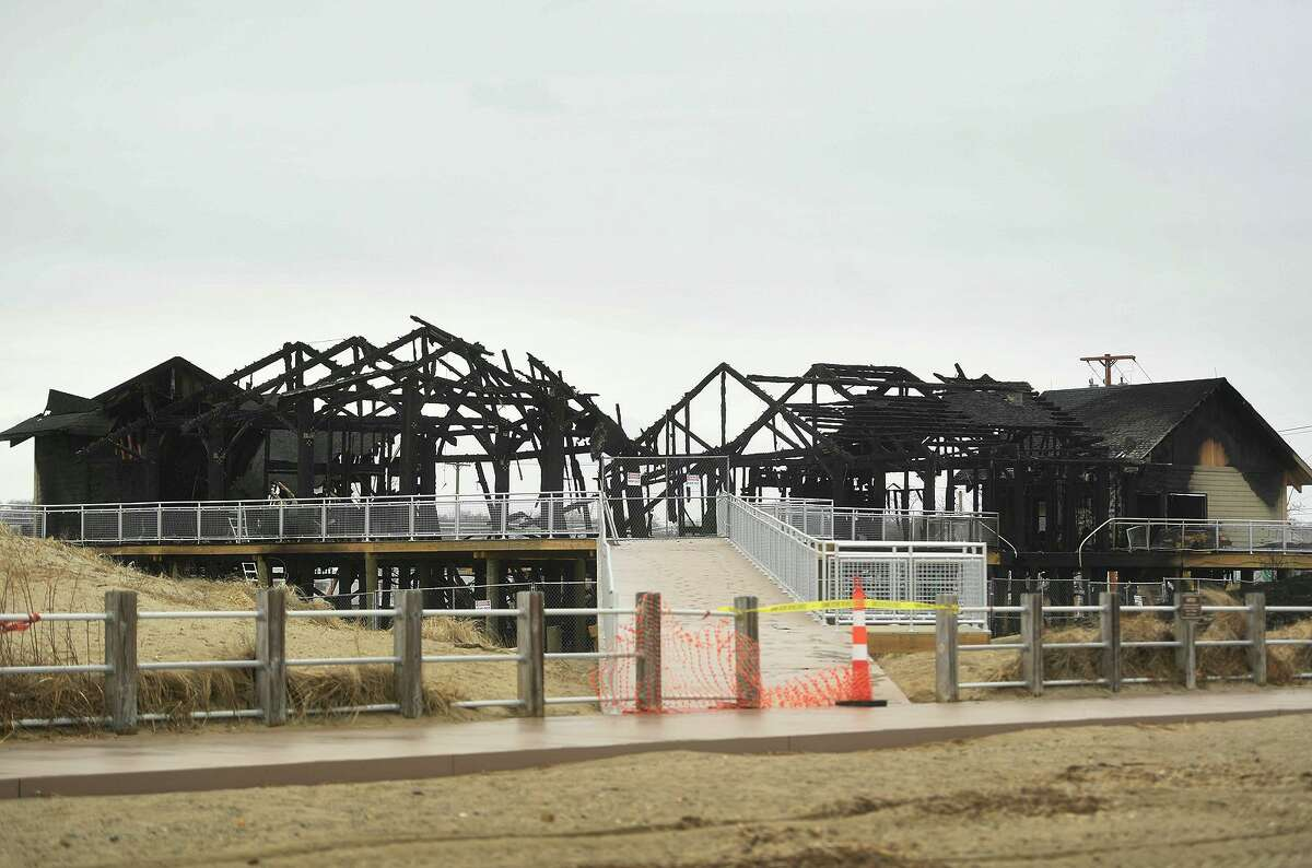 The charred, skeletal remains of the new concessions, bathrooms, and offices at Silver Sands State Park in Milford, Conn. on Wednesday, March 20, 2019. The new construction was completely destroyed in a fire late Tuesday night, March 19, that was fully involved when firefighters arrived on scene.