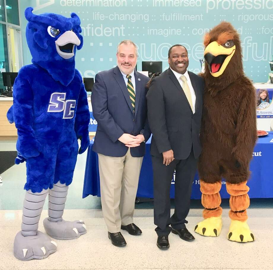 Southern Connecticut State University President Joe Bertolino and Housatonic Community College President Paul Broadie II pose with their respective mascots at a Meet the Presidents event to discuss joint ventures between the two institutions. April 29, 2019 Photo: Linda Conner Lambeck