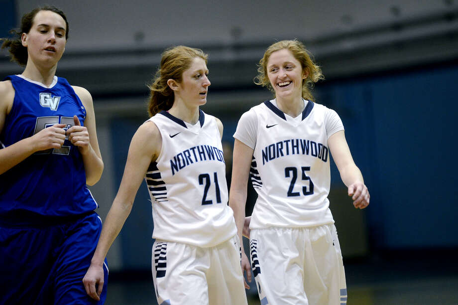 Northwood's Sarah Susan (left) and Kaitlin Susan share a laugh during a Jan. 25, 2014 game against Grand Valley State. Photo: Daily News File Photo