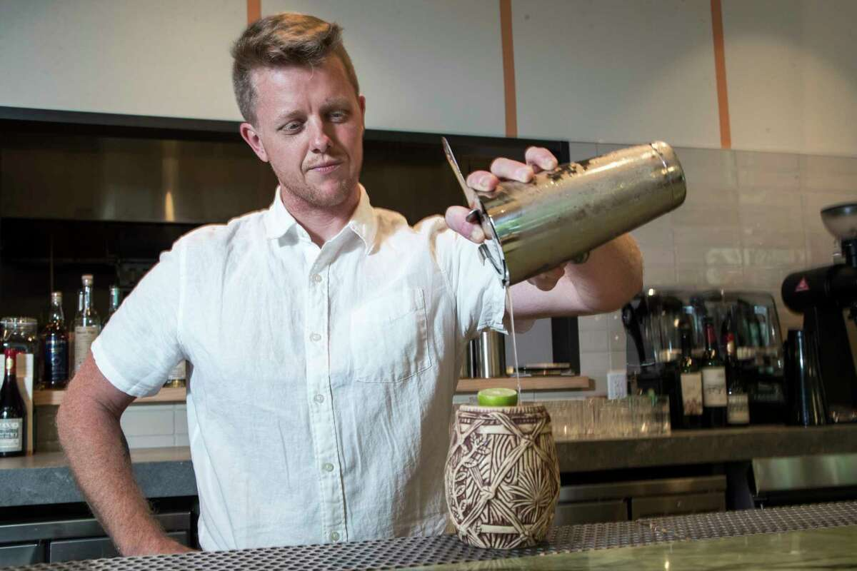 Beverage consultant Kenny Freeman mixes a Volcanos of Antigua cocktail at the new Tropicales.