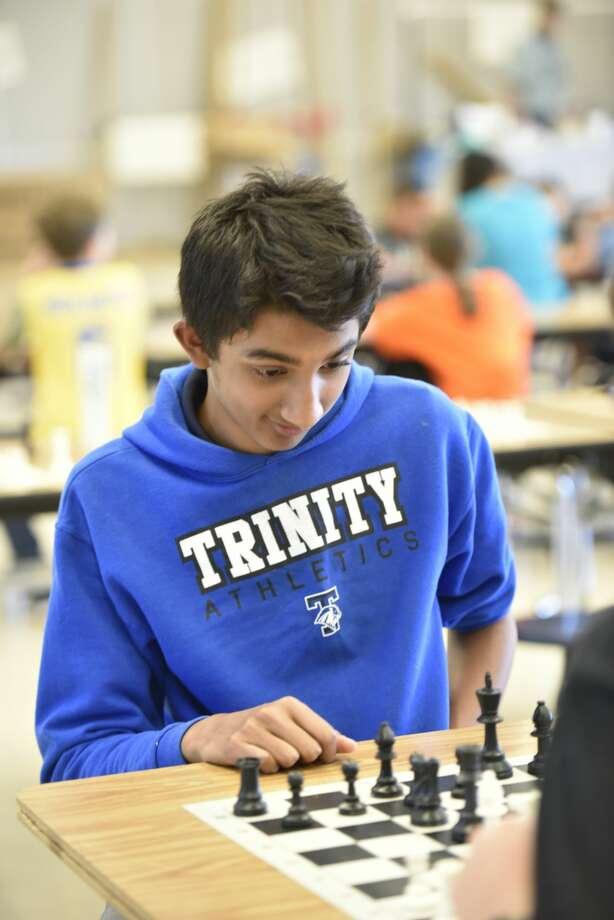 Ayushman Mallik, a 7th grader at Trinity School, during the Texas Chess Association Region IX Chess Tournament, April 27, 2019, at Brooks Middle School in Greenwood. Mallik won first place for grades 7-12. James Durbin/Reporter-Telegram Photo: James Durbin / Midland Reporter-Telegram