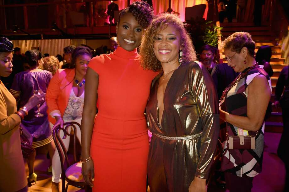 "Creator/Actress Issa Rae (L) and actress Amanda Seales attend the HBO's ""Insecure"" Premiere - After Party at Studio 11 on October 6, 2016 in Los Angeles, California. Photo: Jeff Kravitz/FilmMagic"