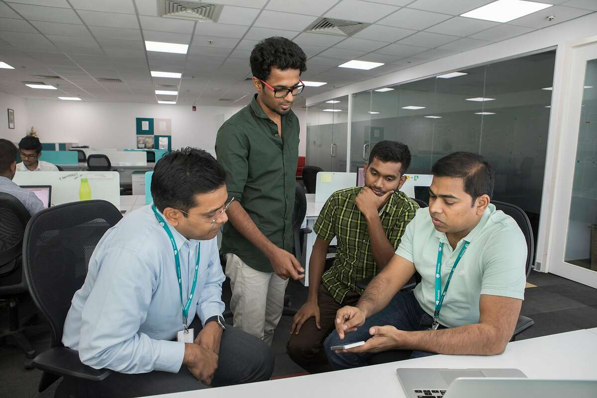 Suren Ramasubbu, left, chief executive of Mobicip, a parental-control iPhone app which Apple removed from the App Store in February, discusses the app with colleagues in Bengaluru, India, March 15, 2019. Last year, with much fanfare, Apple unveiled a screen-time tracker of its own. Then it quietly began purging competitors from its store. (Samyukta Lakshmi/The New York Times)
