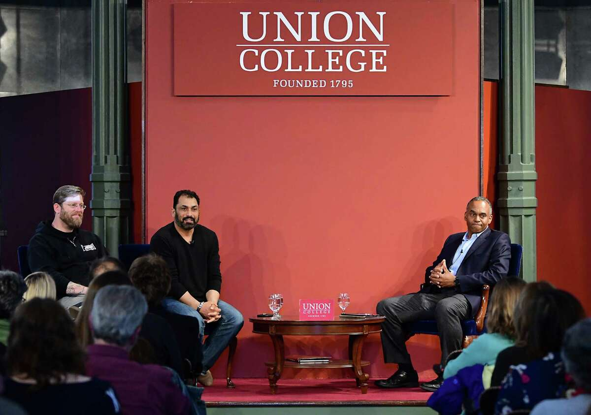 Former white supremacist Arno Michaelis, left, and Pardeep Singh Kaleka, son of man who was killed in racist massacre in Wisconsin, second from left, have joined forces in an anti hate group and spoke at Nott Memorial chapel at Union College on Monday, April 29, 2019 in Schenectady, N.Y. Union president David Harris sits at right. (Lori Van Buren/Times Union)