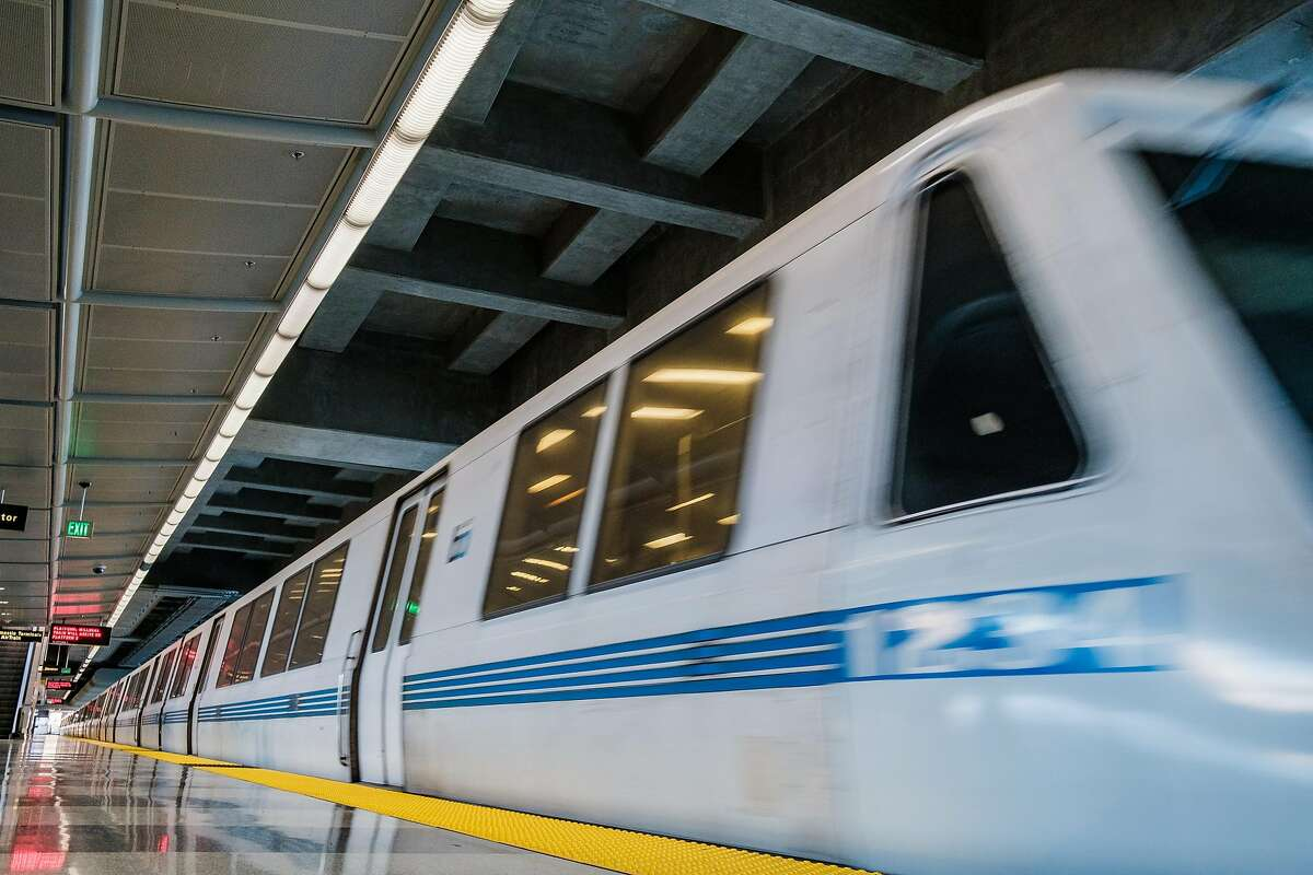 A train is seen at the platform of the SFO BART station.