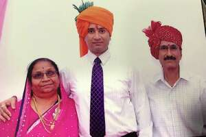 Jyotiben, left, Snehal, center, and Makansinh Udavat pose for a family photo during Snehal's wedding in 2013. Makansinh Udavat was shot and killed at the Quick Stop convenience store in August 2016. His wife Jyotiben was shot once trying to defend her husband. Ralph Torres, 24, was later arrested in connection with the crime and charged with capital murder.