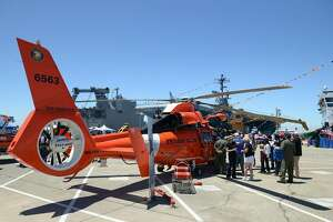 A rescue helicopter from Coast Guard Air Station San Francisco is on display at the inaugural Coast Guard Festival in Alameda.