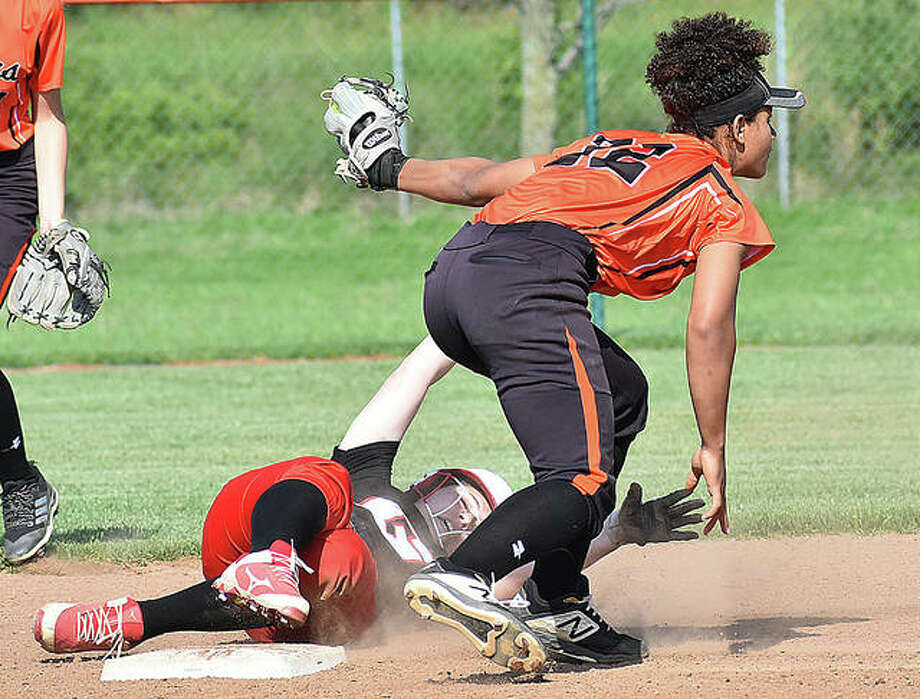 Edwardsville shortstop Maria Smith looks to the umpire to the call after applying the tag to a Chatham Glenwood would-be base stealer. Photo: Matt Kamp/The Intelligencer