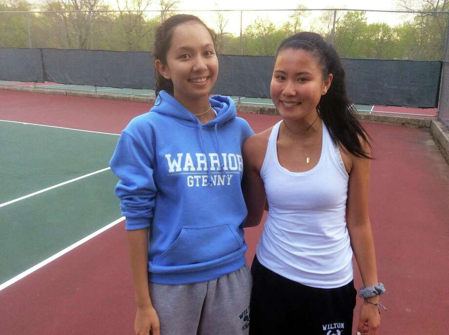 Arden Lee left, and Amber Li of Wilton registered a victory at No. 1 doubles against Greenwich that gave the Warriors a 4-3 win over the Cardinals on Monday in Greenwich. Photo: David Fierro / Hearst Connecticut Media / Connecticut Post