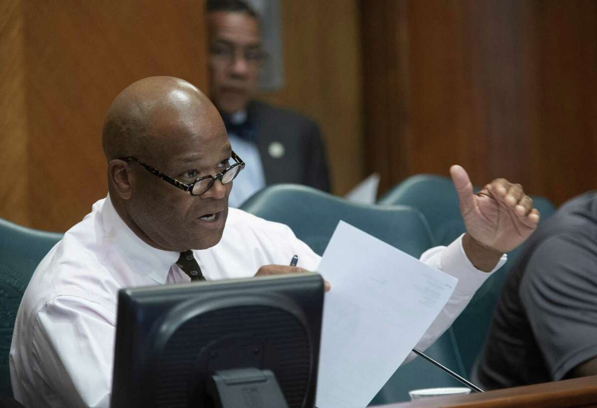 Councilman Dwight Boykins addresses Houston Fire Department Chief Sam Pena during a Houston City Council ethics committee meeting about a plan to demote firefighters at City Hall in Houston, Monday, April 29, 2019.